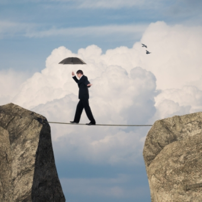 Man balancing on tightrope